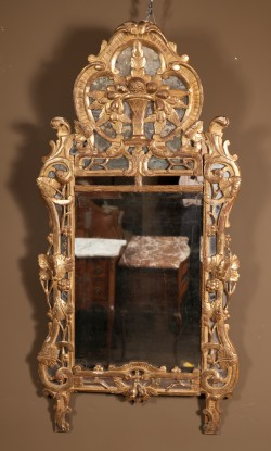 French 18th Century Regence Carved Gold Leaf Mirror Featuring a Rare Center Beveled Glass
