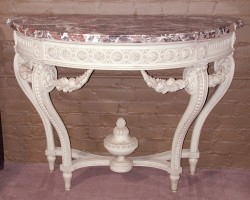 One of a Pair of painted wood consoles